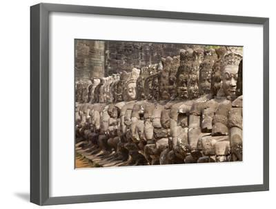 Stone Statues of Evil Line the Right Side of a Bridge At Angkor Thom-Kent Kobersteen-Framed Photographic Print