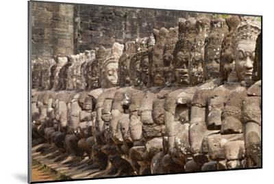Stone Statues of Evil Line the Right Side of a Bridge At Angkor Thom-Kent Kobersteen-Mounted Photographic Print