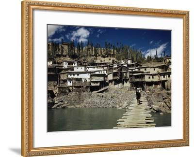 A Man On a Wood Dock Near an Indian Village-Volkmar Wentzel-Framed Photographic Print