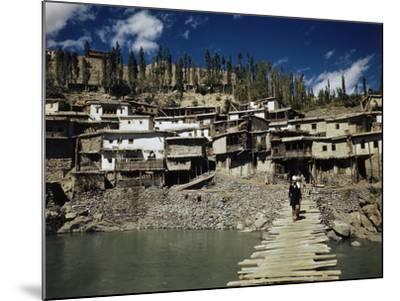 A Man On a Wood Dock Near an Indian Village-Volkmar Wentzel-Mounted Photographic Print