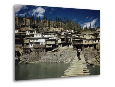 A Man On a Wood Dock Near an Indian Village-Volkmar Wentzel-Metal Print
