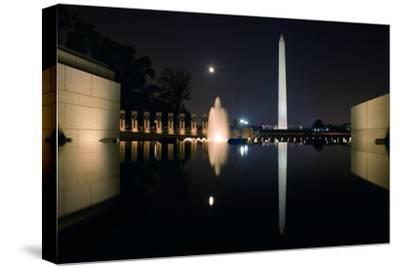 The Washington Monument Reflected in the World War II Memorial Pool-Vickie Lewis-Stretched Canvas Print