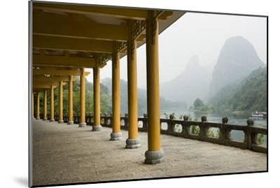 The Li River Runs Past a Covered Walkway by the Karst Formations-Jonathan Kingston-Mounted Photographic Print