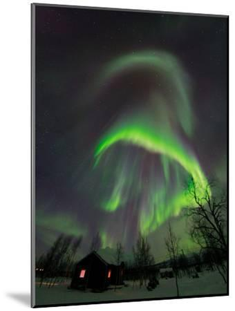 The Aurora Borealis Over a Sami Village House-Babak Tafreshi-Mounted Photographic Print