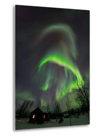 The Aurora Borealis Over a Sami Village House-Babak Tafreshi-Metal Print