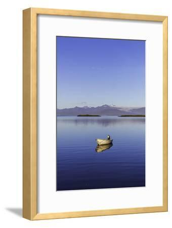 A Johnboat with An Outboard Motor and Its Reflection in Calm Blue Water-Jonathan Irish-Framed Photographic Print