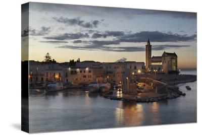 A Dusk View of the Fishing Harbor of Trani-Nigel Hicks-Stretched Canvas Print