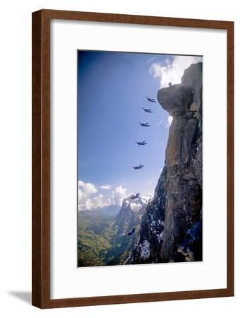 A Base Jumper Leaps Off the Mushroom, North Face of the Eiger, Bernese Oberland of the Swiss Alps-Cory Richards-Framed Photographic Print