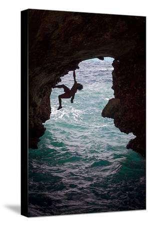 A Rock Climber Climbing Without Ropes Above the Mediterranean Sea-Cory Richards-Stretched Canvas Print