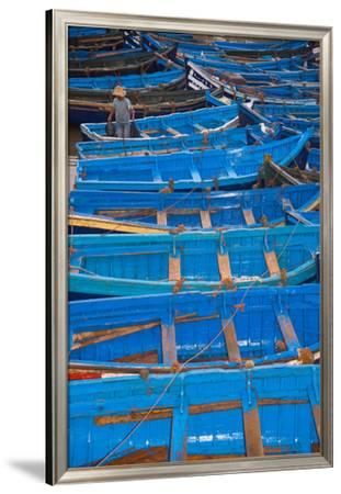 A Fisherman Stands in the Traditional Blue Boats of Essaouira Harbor-Cristina Mittermeier-Framed Premium Photographic Print