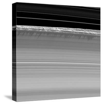 Towering Walls of Ice Rubble Cast Long Shadows on the Outer Edge of Saturn's B Ring--Stretched Canvas Print