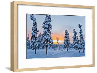 Orange Sky at Sunset Over Snow-covered Evergreens and a Tee Pee Form-Mike Theiss-Framed Photographic Print