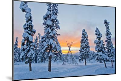 Orange Sky at Sunset Over Snow-covered Evergreens and a Tee Pee Form-Mike Theiss-Mounted Photographic Print