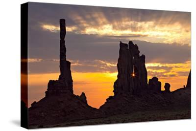 Silhouetted Totem Pole and Yei Bi Chei Rock Formations at Sunrise-Derek Von Briesen-Stretched Canvas Print
