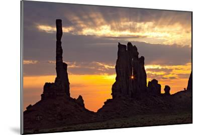 Silhouetted Totem Pole and Yei Bi Chei Rock Formations at Sunrise-Derek Von Briesen-Mounted Photographic Print