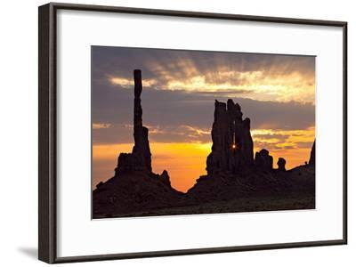 Silhouetted Totem Pole and Yei Bi Chei Rock Formations at Sunrise-Derek Von Briesen-Framed Photographic Print