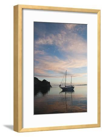 A Sailboat Anchored in a Bay During a Colorful Sunset-James Forte-Framed Photographic Print