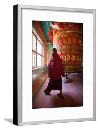 A Monk Spins the Worlds Largest Prayer Wheel Near Boudhanath Stupa-Ben Horton-Framed Photographic Print