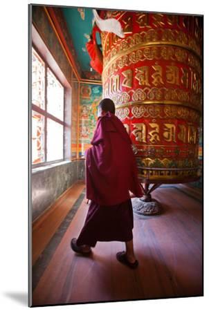 A Monk Spins the Worlds Largest Prayer Wheel Near Boudhanath Stupa-Ben Horton-Mounted Photographic Print