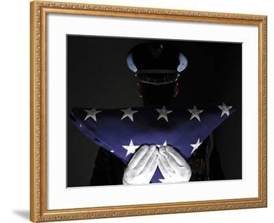 U.S. Airman Stands at Attention After Completing the Flag Dressing Sequence-Stocktrek Images-Framed Photographic Print