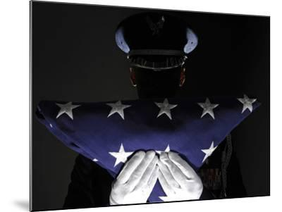 U.S. Airman Stands at Attention After Completing the Flag Dressing Sequence-Stocktrek Images-Mounted Photographic Print