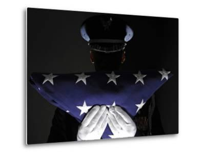 U.S. Airman Stands at Attention After Completing the Flag Dressing Sequence-Stocktrek Images-Metal Print