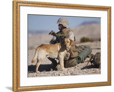 A Yellow Labrador Retriever And His Handler Take a Break in the Desert-Stocktrek Images-Framed Photographic Print