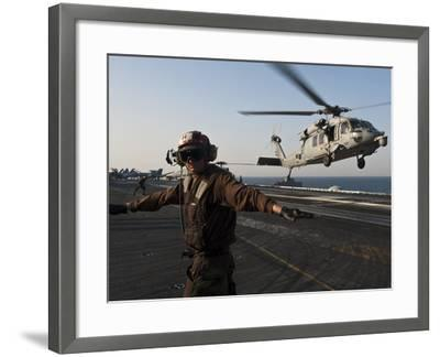 Airman Checks For a Clear Deck As An MH-60S Sea Hawk Takes Off USS John C. Stennis-Stocktrek Images-Framed Photographic Print