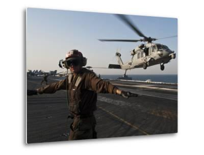 Airman Checks For a Clear Deck As An MH-60S Sea Hawk Takes Off USS John C. Stennis-Stocktrek Images-Metal Print