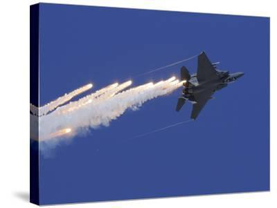 An F-15E Strike Eagle Releases Flares-Stocktrek Images-Stretched Canvas Print