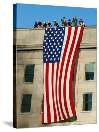 Fire And Rescue Workers Unfurl a Huge American Flag Over the Side of the Pentagon-Stocktrek Images-Stretched Canvas Print
