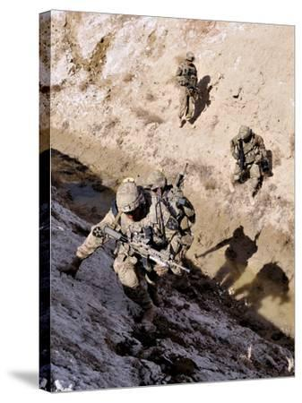 Soldiers Approach a Suspected Weapons Cache in Afghanistan-Stocktrek Images-Stretched Canvas Print