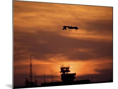 A MQ-1 Predator Over COB Speicher at Sunset, Tikrit, Iraq-Stocktrek Images-Mounted Photographic Print