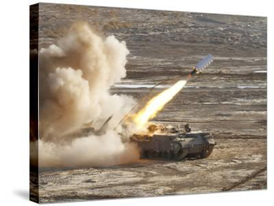 An Israel Defense Force Puma M26 Launches a Mine Clearing Line Charge-Stocktrek Images-Stretched Canvas Print