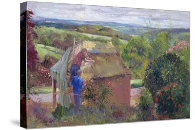Thatching the Summer House, Lanhydrock House, Cornwall, 1993-Timothy Easton-Stretched Canvas Print