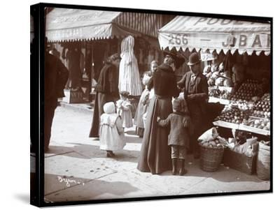 View of Women with Children Shopping at a Fruit and Vegetable Stand at 266 7th Avenue, New York,…-Byron Company-Stretched Canvas Print