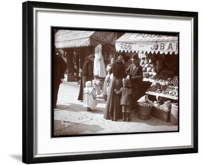 View of Women with Children Shopping at a Fruit and Vegetable Stand at 266 7th Avenue, New York,…-Byron Company-Framed Giclee Print