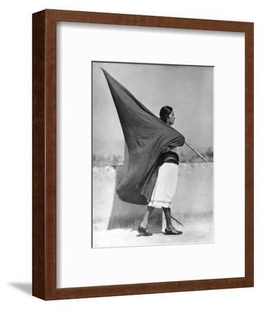 Woman with Flag, Mexico City, 1928-Tina Modotti-Framed Photographic Print