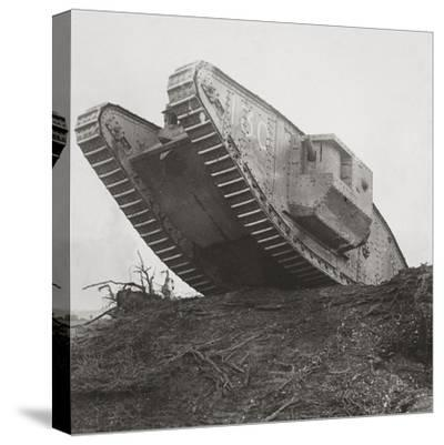 A Tank Leads the Infantry into Action and Breaks Down the Wire Entanglements-English Photographer-Stretched Canvas Print