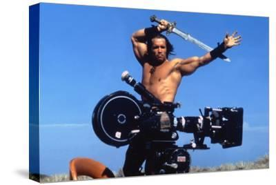 Conan the Barbarian 1982 Directed by John Milius on the Set, Arnold Schwarzenegger.--Stretched Canvas Print