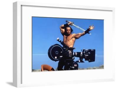 Conan the Barbarian 1982 Directed by John Milius on the Set, Arnold Schwarzenegger.--Framed Photo