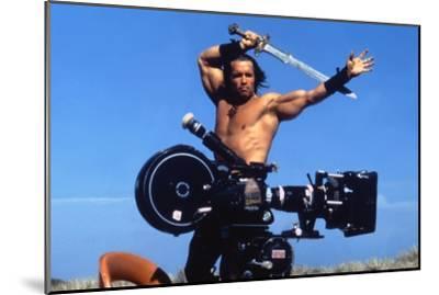 Conan the Barbarian 1982 Directed by John Milius on the Set, Arnold Schwarzenegger.--Mounted Photo
