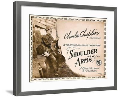 SHOULDER ARMS, on left: Charles Chaplin (aka 'Charlie Chaplin') on Title Card, 1918.--Framed Art Print