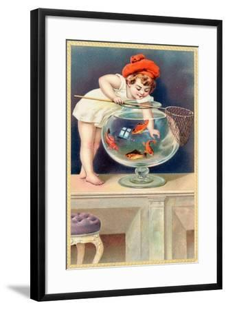 A Young Child with a Fishing Net Reaches into a Goldfish Bowl--Framed Giclee Print