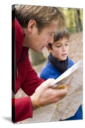Father And Son Reading a Map-Ian Boddy-Stretched Canvas Print