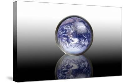 Earth In a Crystal Ball, Conceptual Image-Victor De Schwanberg-Stretched Canvas Print