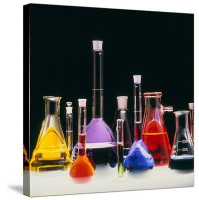 Assortment of Laboratory Flasks Holding Solutions-Tek Image-Stretched Canvas Print