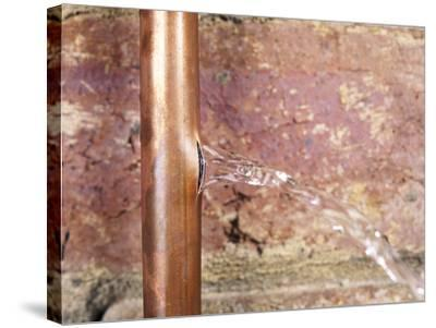 Burst Water Pipe-Andrew Lambert-Stretched Canvas Print