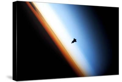 Space Shuttle Over Earth's Horizon--Stretched Canvas Print