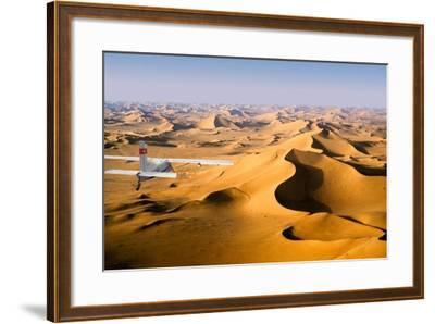 Small Plane Flying Above Giant Sand Dunes in Morning Light, Grand Erg Oriental, Algeria--Framed Photographic Print